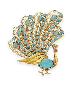 A TURQUOISE AND GOLD PEACOCK BROOCH  Designed as an oval cabochon turquoise body with a circular-cut ruby eye, extending cabochon turquoise and gold wirework tail feathers, mounted in gold