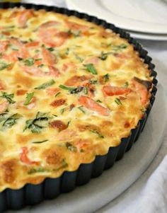 Use leftover salmon to create an entire meal with this Salmon Quiche Recipe! It's perfect for dinner or lunch and it is a fab addition to family brunch! Salmon Quiche - Use leftover salmon to create an entire meal with this Salmon Quiche Recipe! Quiches, Fish Recipes, Seafood Recipes, Seafood Quiche, Healthy Dinner Recipes, Breakfast Recipes, Breakfast Ideas, Salmon Quiche, Leek Quiche