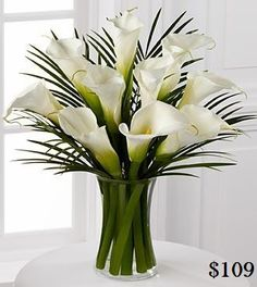 Real Touch Calla Lilys. REAL TOUCH Flower Arrangements LOOK and FEEL REAL and are permanently set hard in a clear ARTIFICIAL WATER, guaranteed to look fresh forever. Handmade, modern Flower Arrangements that are ideal for Allergy Sufferers. Perfect for Home Decor, Weddings, Offices and Special Occasions. Flower Arrangements come exactly as pictured, with flowers, vase and simulated water. Easy to clean with baby wipes. Pick-up welcome or cheap courier delivery available Australia wide.