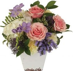 Geraldine roses are nestled in a distinctive ceramic container with freesia, hydrangea, trachyllium and carnations. Carnations, Shop Ideas, Hydrangea, Pink Roses, Floral Arrangements, Centerpieces, Floral Wreath, Palette, Container