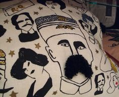 Fine Cell Work moustache cushion stitched by Mr Anonymous