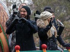 Avi making hearts during the Macy's Thanksgiving Day Parade I caaaaannn'tt.