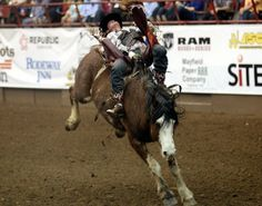 Jared Schlegal is bucked during the bareback riding at the 82nd annual San Angelo Stock Show and Rodeo at the Foster Communication Coliseum Saturday evening.