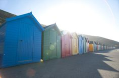 Free Stock Photo: Brightly coloured beach huts over the sunlight in Whitby West Cliff - By freeimageslive contributor: photoeverywhere Beach Huts, Cliff, Free Stock Photos, Sunlight, Bright Colors, Shed, British, Outdoor Structures, Outdoor Decor