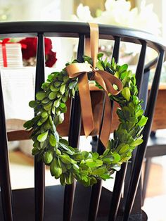 love wreaths tied to chairs