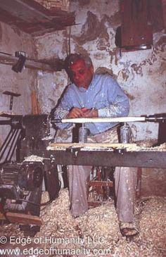 Syrian man working in a wood shop.