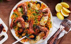 FESTIVE SEAFOOD PAELLA - A truly spectacular dish originating from Spain, combines well known and easy-to-find seafood in a spicy and heart-warming rice dish. Seafood Paella, Seafood Dishes, Layer Chicken, Romantic Meals, Christmas Dishes, Rice Dishes, Cooking Classes, Good Food, Awesome Food