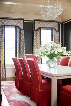 Give your dining room a formal look with a cornice above the drapery panels.