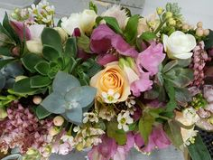Weddings and Events - table floral arrangement with pretty flowers and succulents