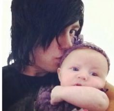 """Ok I just want to get this off my chest. This is kellin quinn from sleeping with sirens and his little daughter. I've had many people bully me for the music that I listen to because it's not normal. I've had adults look at me weirdly because my music is """"provocative"""" or influencing self harm and suicide. DOES THIS AMAZING MAN WITH HIS BABY GIRL WHO HE LOVES AND WILL ALWAYS LOVE LOOK PROVOCATIVE? DOES HE LOOK LIKE HE PROMOTES SELF HARM? I. THINK. NOT."""