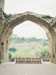 This fine art Italian wedding inspiration is overflowing with organic florals, romantic place settings, vintage inspired bridal fashion and picturesque views. Truly, La Badia di Orvieto is a dreamy destination wedding venue if we ever saw one! If you love the old world romance aesthetic, see this gallery in full on Ruffled now. #italyweddingmood #bridalcaftan #tablescapeinspo