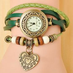 Boho-Chic Vintage-Inspired Fashion Watch with Heart Charm - Red Gone are the days of wearing a watch just to count down the minutes until 5:00 rush out the office door - now you can check the time and create your own unique style with the Women's Boho-Chic Vintage-Inspired Fashion Watch! With this unique bohemian accessory, you will be the envy of any vintage and fashion enthusiast. This faux leather woven cuff-style bracelet is embellished by gorgeous beads and a cute Owl charm.