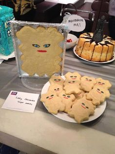 clever. Lady Cassandra cookies. Notice in the back! A weeping angel food cake! Haha! Puns