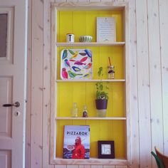 Yellow kitchen shelf built in the left over space from an old door. Extreme Makeover Home Edition, Kitchen Shelves, Locker Storage, Bookcase, Shelf, Space, Yellow, Furniture, Home Decor