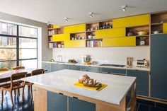 I like the use of block colours in the cabinetry but a little hectic or crowded.