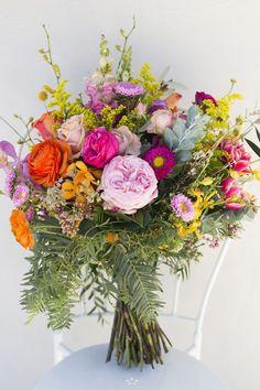 Bright rainbow wedding bouquet | Lyndal Carmichael Photography #weddingbouquets