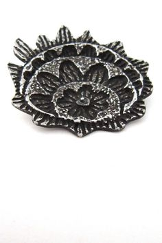 """Robert Larin, Canada - pewter """"flames and flowers"""" brooch"""