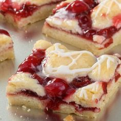 A Sweet and delicious recipe for cherry bars topped with yummy icing.