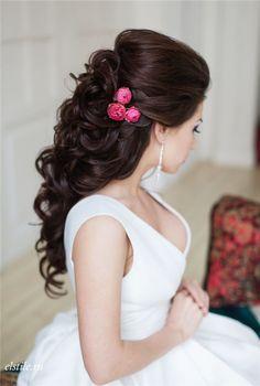 black half down half up bridal hairstyle with pink flowers