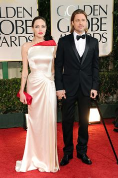 The 69th Annual Golden Globe Awards    Angelina Jolie, in Atelier Versace, with Lorraine Schwartz jewels and a Christian Louboutin clutch, with Brad Pitt, in Salvatore Ferragamo.