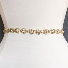 Add a little sparkle to wedding dress, or as a bridesmaid belt! Highest quality crystal. The crystals are in a gold setting and in a