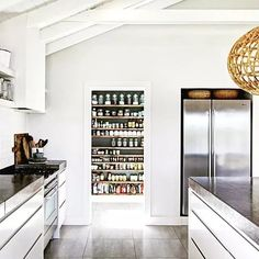 the grove byron bay - pantry + kitchen area. stainless steel fridge + spacious pantry // butlers kitchen.