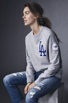 "For game day or every day, we've got your bases covered. Introducing - the Levi's x MLB Collection, featuring the LA Dodgers crew neck sweatshirt. It's detailed with Dodgers logos in ""tackle twill"" appliqué - a technique commonly used for uniforms, providing a uniquely athletic touch. Classic crew features include a vintage V-stitch at the neck, and banded cuffs and hem to keep cold air out. Made from a versatile knit with ribbed side panels for added comfort. Get it before it's gone!"