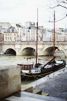 LOVELY. COULD BE A BOAT TIED TO ANY OLD DOCK, BUT NO -- THE BRIDGE TELLS IT -- PARIS, OF COURSE.--SLA