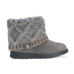 Moccasin colored faux suede winter ankle bootie with a grey cable knit upper and decorative button.