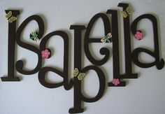 Lowercase name letters in alternating princess pink and carribean blue with ribbons and flowers.