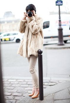 """Vintage style faux fur swing coat donned by a young photographer during a """"shooting party"""" outside the entrance to a big fashion show, Paris, March 2012"""