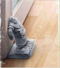 Hodor door stopper. that is smart  that is smart