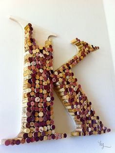 so i finally made some wall art with all the wine corks i have been collecting for years. check out the page i quickly created for more photos and a description of how to make one yourself :) @Kelly Garrett