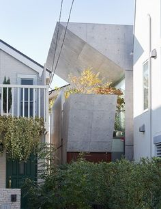 """The """"Bent House"""" by Koji Tsutsui & Associates is made up of what the architect refers to as """"a collection of three bent boxes,"""" each of which has a skylight."""