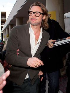 CANE & ABLE  Just hours after wowing fans with Angelina Jolie at the Golden Globes, Brad Pitt gets back to work in L.A. on Monday, signing autographs for fans while promoting Moneyball.
