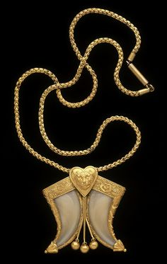 Tiger claw jewelry became a very popular gift for army officers serving in India to send back to their wife or sweetheart. Possibly accompanied with a (most likely fictional) thrilling tale of the claws' origins. This necklace dates to 1866.