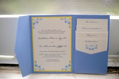 blue and yellow wedding invitations, like the  way the inserts were stacked and visible