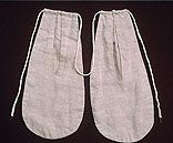 white cotton or linen pockets on a drawstring  Womens clothes did not have attached  pockets. a pocket or two A pocket or two would be tied around a womans waist before she put her final clothes on.Gowns and petticoats had slits in the sides for access to pockets.