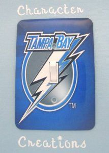 "TAMPA BAY LIGHTNING Hockey Team Standard Metal Light switch Cover (Switch plate Switchplate) by Character Creations. $12.00. High Quality Steel Switchplate with Beautiful Satin Finish. NOT a Sticker.  Image is heat sealed into the switchplate, therefore is completely washable.. Tampa Bay Lightning Design. Beautifully finishes off any room. Standard Size Lightswitch Cover (3 1/2"" x 5""). This is a fantastic addition to any bedroom, recroom or office and is made from Hi..."