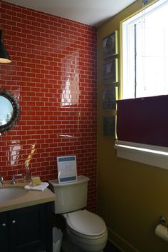 2008 Cottage Living Magazine Idea House. Color, subway tiles, and hanging roller blinds upside-down for privacy.