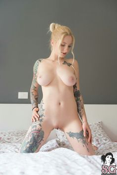Naked girl with tattoo