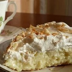 Old Fashioned Coconut Cream Pie (thickened with flour)  •1 cup sweetened flaked coconut •3 cups half-and-half •2 eggs, beaten •3/4 cup white sugar •1/2 cup all-purpose flour •1/4 teaspoon salt •1 teaspoon vanilla extract •1 (9 inch) pie shell, baked •1 cup frozen whipped topping, thawed