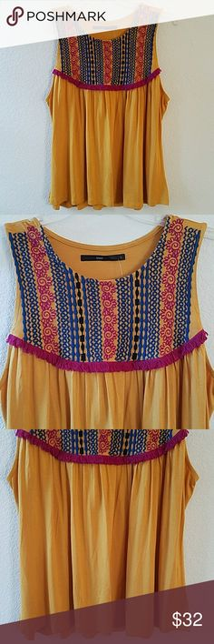 "Azel Hazel Embroidered Top NWOT Beautiful brand new without tag Azel Hazel Embroidered Top. Mustard. No stains or damages. Armpit to armpit without stretching approx 21"". Approx length of top in front 25 1/2"". Tops"