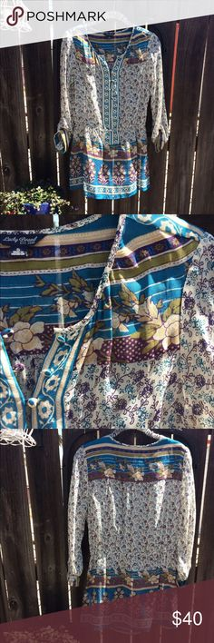Lucky Brand Blouse Sheer rayon flowered blouse with sweet buttons halfway down the front and a cinched waist. Excellent condition. Never been worn. Lucky Brand Tops Blouses