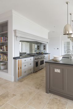 Project: Ashurst House | Kitchen Design: Nickleby | The Nickleby design embodies the true spirit of the classic contemporary kitchen. #humphreymunson #kitchen #island #lacanche #jimlawrence