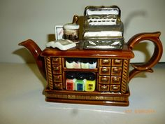 """Collectible Paul Cardew Miniature Cash Register Teapot #PaulCardew PAUL CARDEW """" SIGNED"""" MINIATURE TEAPOT.  THIS POT IS APPROXIMATELY 6 1/4  LONG FROM THE SPOUT TO END OF THE HANDLE.  IT IS APPROXIMATELY 3 5/8 INCHES HIGH AND A DEPTH OF  2 1/4 INCHES."""