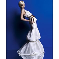 Brides: Wild Hautes. Layer Cake� Poufy proportion is fashion's new sweetheart. Treat yourself to an ivory-taffeta-tiered bubble skirt and georgette tank tied with a spice-colored velvet ribbon, by special order, Vera Wang, verawang.com. Rock-crystal earrings and ring, by Diane von Furstenberg by H. Stern Collection, and necklace, H. Stern, hstern.net.