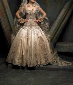 St. Pucchi St. Pucchi Couture 9301: buy this dress for a fraction of the salon price on PreOwnedWeddingDresses.com