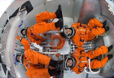 Spacesuit engineers demonstrate how four crew members would be arranged for launch inside the Orion spacecraft, using a mockup of the vehicle at Johnson Space Center. Nasa Missions, Moon Missions, Glass Cockpit, Space Launch System, Orion Spacecraft, American Space, Johnson Space Center, Nasa Photos, Space Program