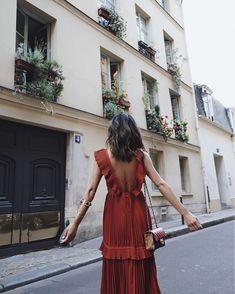 Paris in a feminine red dress.